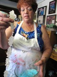 Debbie Ball, 60, owner of The Candy Lady store in Albuquerque, N.M., displays her new line of meth candy made from sugar rock candy.