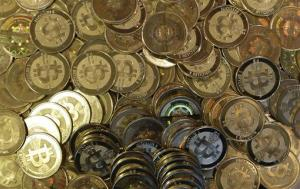 This April 3, 2013 photo shows bitcoin tokens at 35-year-old software engineer Mike Caldwell's shop in Sandy, Utah. Caldwell mints physical versions of bitcoins.