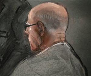 In this courtroom sketch, James Whitey Bulger listens to defense attorney, Hank Brennan, during closing arguments at U.S. District Court, in Boston, Aug. 5, 2013.