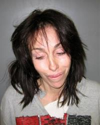 In this undated file photo orginially released Thursday, Feb. 7, 2008, by the Nye County Sheriff's Office, former Hollywood madam Heidi Fleiss is shown in a booking mug in Pahrump, Nev.