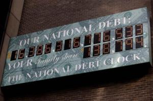 A sign showing the U.S. national debt is displayed in New York, Monday, Dec. 31, 2012.