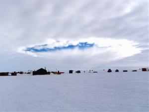 This photo taken Dec. 12, 2009, shows an aircraft-induced hole observed at the West Antarctic Ice Sheet Divide Camp, Antarctica.