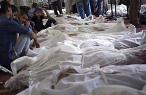 Egyptians mourn over the bodies of their relatives in the El-Iman mosque in Nasr City, Cairo, Egypt, Thursday.