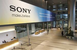 In this April 10, 2012 file photo, the main lobby of the headquarters of Sony Corp. in Tokyo is hung with a large sign reading: Sony make.believe.