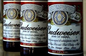 Bottles of Budweiser beer are seen at the Stag Brewery in London.