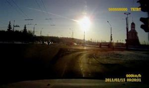 In this frame grab made from a video done with a dashboard camera a meteor streaks through the sky over Chelyabinsk.