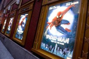 In this Dec. 22, 2010 file photo, posters for the Broadway musical Spider-Man Turn: Off the Dark hang outside the Foxwoods Theatre in New York.