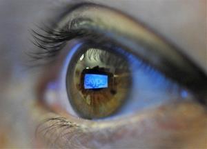 In this Jan. 11, 2011 file photo, the Skype logo is reflected in the eye of a reader.