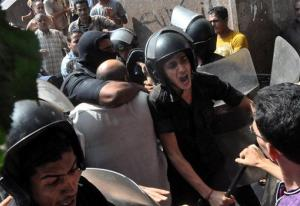 Egyptians security forces escort an Islamist supporter of the Muslim Brotherhood out of the al-Fatah mosque.