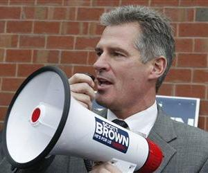 In this Oct. 24, 2012, file photo, then-Sen. Scott Brown, R-Mass., uses a bull horn at a campaign stop in Watertown, Mass.