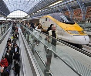 This Oct. 19, 2010 photo from files shows passengers walking by a German Intercity Express (ICE) high speed train, left, and a Eurostar high speed train at St. Pancras International Station in London.