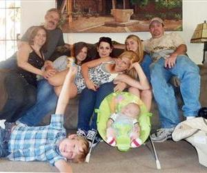 Seated from left: Christina Anderson; Christopher Saincome; Christina's sisters Samantha Saincome and Andrea Saincome; their niece Hannah Anderson, reclining; Alexi (friend of Hannah's), and DiMaggio.