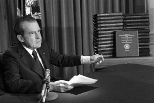 In this April 29, 1974 photo, President Richard M. Nixon points to the transcripts of the White House tapes.