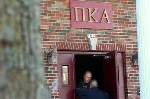 In this Nov. 2, 2012 photo, police officers speak in the doorway of the Pi Kappa Alpha house in DeKalb, Ill.