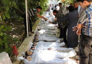 This citizen journalism image provided by the Local Committee of Arbeen which has been authenticated based on its contents and other AP reporting, shows Syrian citizens trying to identify dead bodies, after an alleged poisonous gas attack.