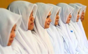 Indonesian Muslim students line up as they practice a traditional Acehnese dance called saman at a high school in Banda Aceh.