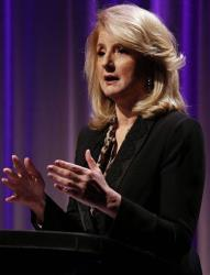 Arianna Huffington, founder of the Huffington Post, delivers a keynote speech to those attending The Third Metric Conference at BAFTA, in London, on Tuesday, July 30, 2013.
