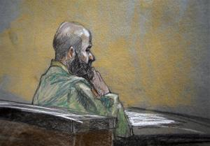 In this courtroom sketch, US Army Maj. Nidal Malik Hasan is shown during closing arguments Thursday. He chose not to give any in his own behalf.