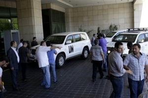 Media cover the arrival of the United Nations high representative for disarmament affairs, Angela Kane, at a hotel in Damascus, Syria, Saturday.