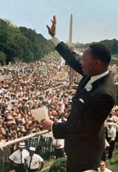 This Aug. 28, 1963, photo shows Dr. Martin Luther King Jr. acknowledging the crowd at the Lincoln Memorial for his I Have a Dream speech.