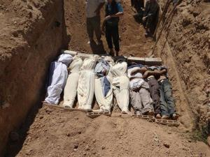 This Aug. 21, 2013, file image, which has been authenticated, several bodies are buried during a funeral in a suburb of Damascus, Syria.