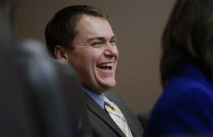 Republican Carl DeMaio laughs during a city council meeting in San Diego.