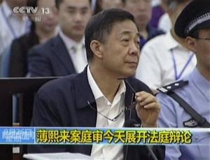 In this image taken from video, former Chinese politician Bo Xilai looks up in a court room at Jinan Intermediate People's Court in Jinan, eastern China's Shandong province, Monday, Aug. 26, 2013. A prosecutor urged a Chinese court Monday to punish disgraced politician Bo with a severe sentence because of...
