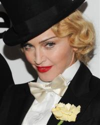 Madonna attends the world premiere of Madonna: The MDNA Tour at the Paris Theatre on Tuesday, June 18, 2013 in New York.