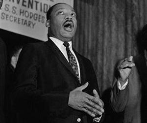 "This file photo shows the Rev. Martin Luther King Jr. joining in singing ""We Shall Overcome"" before he addressed f the Progressive National Baptist Convention in Cincinnati on Sept. 8, 1967."