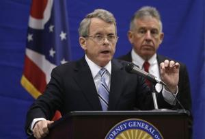 In this Feb. 5, 2013, file photo, Ohio Attorney General Mike DeWine answers questions during a news conference at the Bureau of Criminal Investigation in Richfield, Ohio.