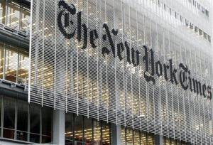 People pass the New York Times building in New York,  Wednesday, Oct. 10, 2012.