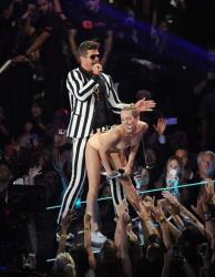 Robin Thicke, left, and Miley Cyrus perform at the 2013 MTV Video Music Awards.