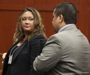 Shellie Zimmerman, left, looks at her husband George Zimmerman as they leave the court room during a recess in his trial at Seminole circuit court in Sanford, Fla., June 14, 2013.