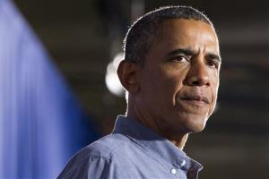In this Aug. 22, 2013 file photo, President Barack Obama pauses while speaking at Henninger High School in Syracuse, NY.