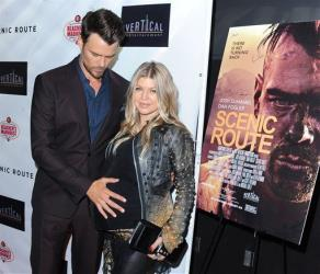 Josh Duhamel and wife Fergie arrive on the red carpet for the premiere of Scenic Route at the Chinese 6 Theater on Aug. 20 in Los Angeles.