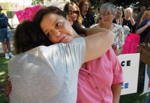 Auliea Hanlon, mother of the victim, receives a hug from a supporter during a Thursday rally in Billings calling for the resignation Judge G. Todd Baugh.
