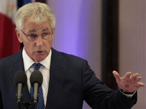 Defense Secretary Chuck Hagel gestures as he answers questions from reporters during his visit at the Malacanang Presidential Palace in Manila, Philippines on Friday,  Aug. 30, 2013.