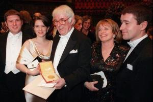 A Sunday, Dec. 10, 1995 photo shows Irish poet Seamus Heaney, center, displaying his Nobel literature prize medal, surrounded by his family.