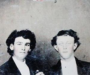 The man on the right might be the infamous Billy the Kid.