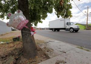A makeshift memorial on a tree is shown, Thursday, Aug. 29, 2013, in Phoenix, where the crash occurred.