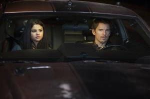 This film image released by Warner Bros. Pictures shows Selena Gomez, left, and Ethan Hawke in a scene from Getaway.