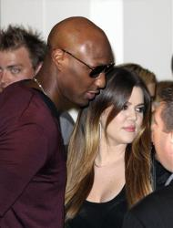Khloe Kardashian and her husband Los Angeles Lakers' Lamar Odom arrive for a launch of the Kardashian fashion accessory range at a department store in Sydney, Australia, Thursday, Nov. 3, 2011.