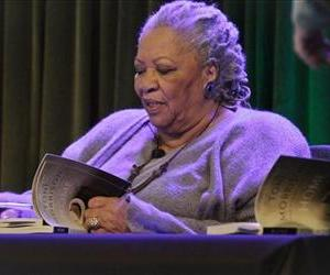 Author Toni Morrison signs copies of her latest book Home, during Google's online program series, Authors At Google, on Wednesday, Feb. 27, 2013 in New York.