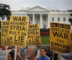Demonstrators take part in a protest calling for no military attack on Syria outside the White House in Washington, Thursday, Aug. 29, 2013.