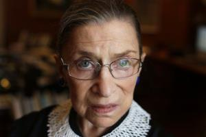 Ruth Bader Ginsburg poses for a photo in her chambers at the Supreme Court in Washington.