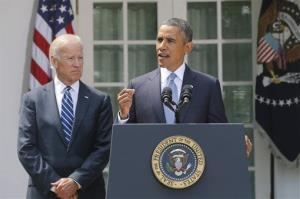 President Obama stands with Vice President Joe Biden as he makes a statement about Syria in the Rose Garden.