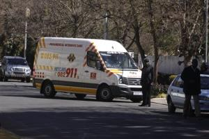 An ambulance transporting former South African president Nelson Mandela arrives at the home of the former statesman in Johannesburg, South Africa, Sunday, Sept. 1, 2013. Mandela has been in hospital for more than two months fighting a recurring lung infection.
