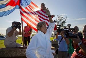 U.S. swimmer Diana Nyad, 64, salutes before her swim from Havana, Cuba, to Florida in Havana on Saturday, Aug. 31, 2013. Endurance athlete Nyad launched another bid Saturday to set an open-water record by swimming from Havana to the Florida Keys without a protective shark cage.