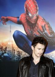 Actor James Franco poses next to a Spiderman 3 poster.