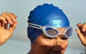 U.S. swimmer Diana Nyad, 64, adjusts her goggles before jumps into the water and start her swim to Florida from Havana, Cuba, Saturday, Aug. 31, 2013. Endurance athlete Nyad launched another bid Saturday to set an open-water record by swimming from Havana to the Florida Keys without a protective...